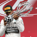 Hamilton wins in Canada and increases lead