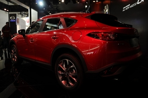 The new SUV shares the same prominent front grille and headlight arrangement with the larger CX-5