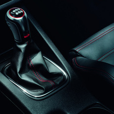 The shift knob is inspired by the golf ball shift knob found on the early GTI and Scirocco