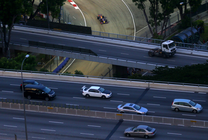 The Singapore Grand Prix runs while traffic continues to flow on the highways above the track