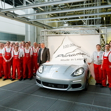 Porsche employees signed the paper banner that the car drove through