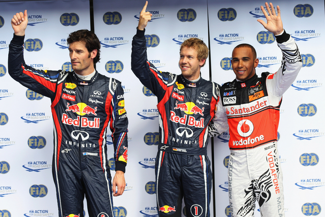 Vettel conquers pole in Spa