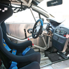 The interior now gets a welded, steel roll cage and either paddle shifters or gearshift