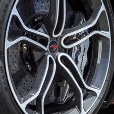 The wheels have a diamond-cut finish with chrome highlights and black details