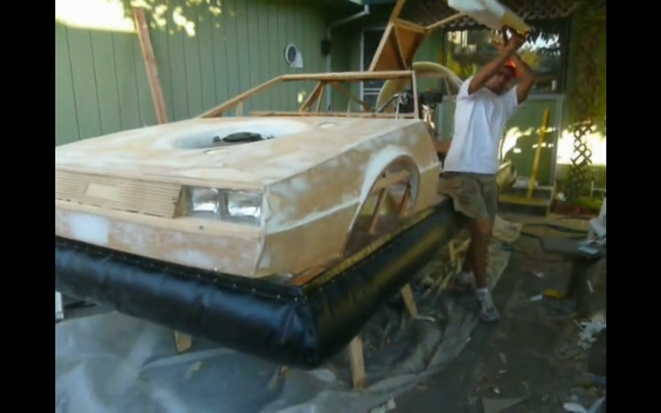 The car has a wooden frame with fiberglass panels