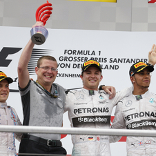 Rosberg went up to the podium alongside Valteri Bottas and Lewis Hamilton