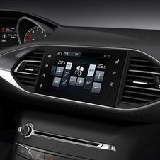 The new infotainment system has a physical volume knob but touch controls