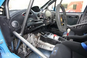 The interior has a FIA legal roll cage