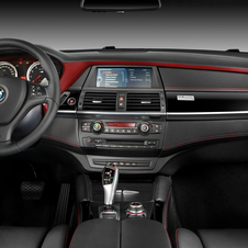 The interior gets Merino leather with red trim