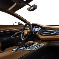 The interior mixes high end materials including rosewood and titanium