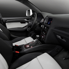 The interior includes aluminum trim and power seats