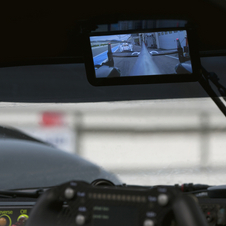 The screen is mounted in the same location as a normal rear-view mirror