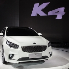 The front design of the large sedan is dominated by the central grille flanked by two large clusters of lighting