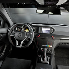 The interior has a large rear-facing camera that shows the driver the cars behind him