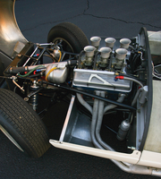 It used a tuned Chevrolet V8 engine mounted in the front