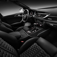 The interior is still quite luxurious with black leather and gloss black trim, carbon fiber and aluminum
