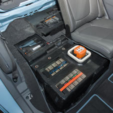 The batteries are stored under the rear seats