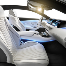 The interior is classy and all white with leather and blue accents