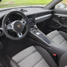 The interior has leather seats with fabric inserts