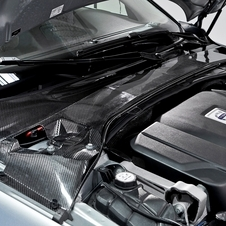 The plenum cover alone weighs 50% less than the conventional car