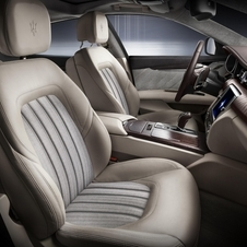 The interior gets high quality, moka leather