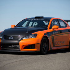 The car is painted Orange Mica with bare carbon fiber