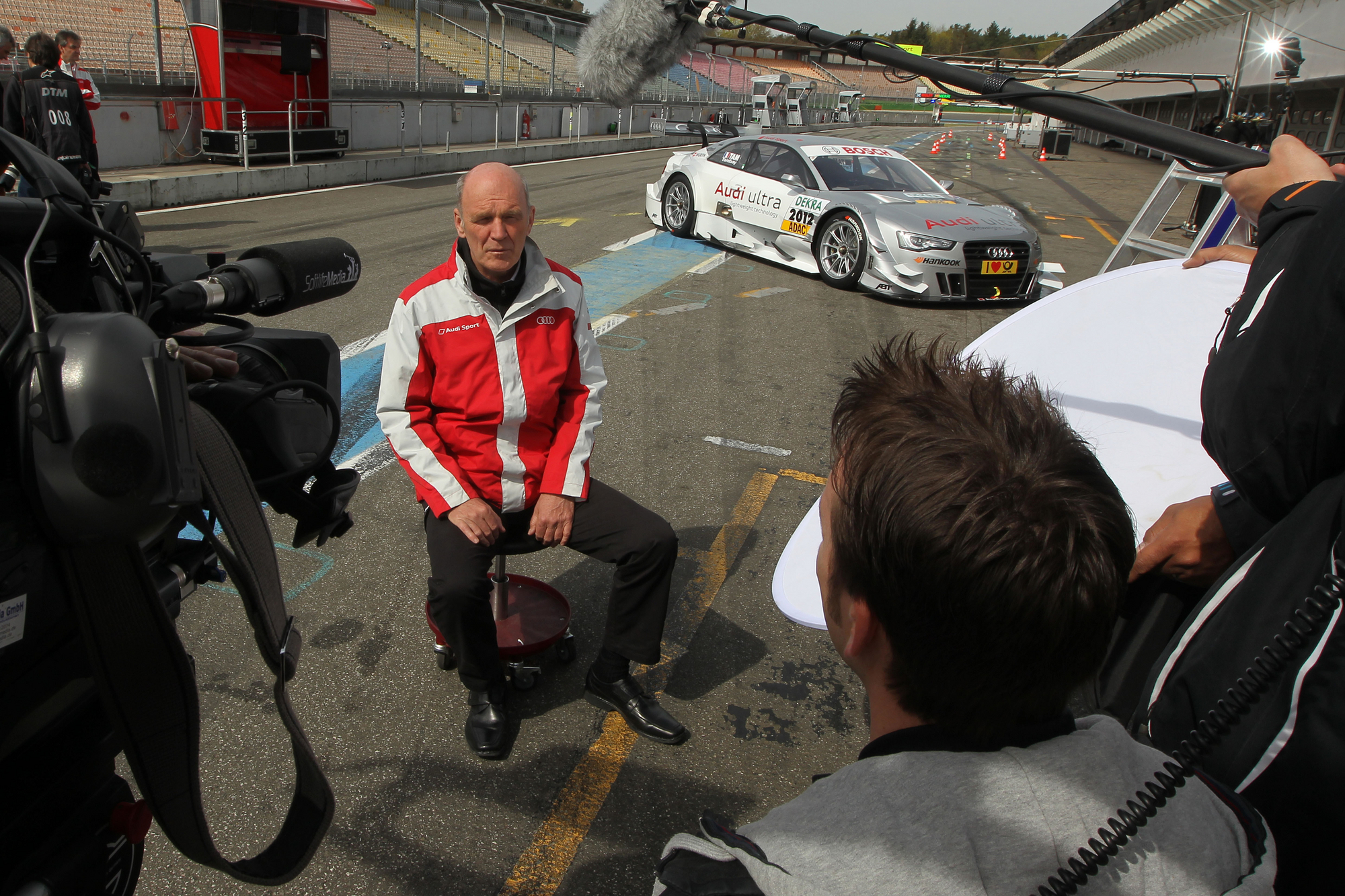 Dr. Ullrich taking interviews in front of the new A5 DTM