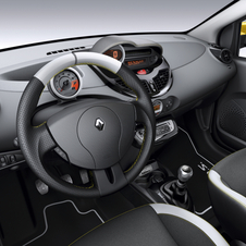 The steering wheel, seats and dashboard have yellow stitching