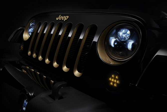 The headlights and grill of the Jeep Wrangler have been accented in gold