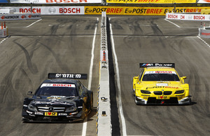 Gary Paffett and Dirk Werner Racing in the third place race in the Munich Olympic Stadium.
