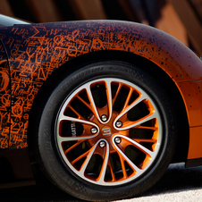 The front wheels have orange details