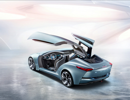 It has gull-wing doors that open to expose all four seats